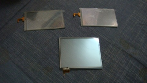 Three touchscreens